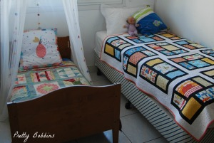 two beds with mama quilts