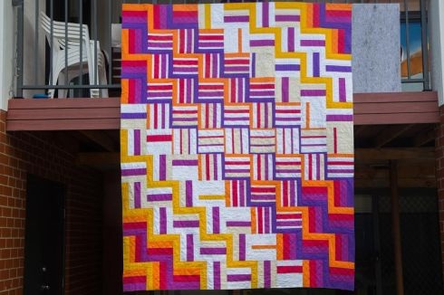 Quilting hanging off a very Aussie verandah.